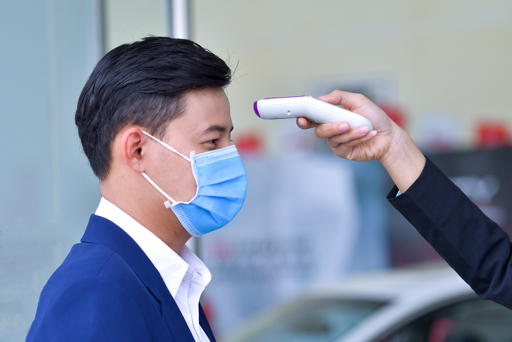 office worker at a health checkpoint before entering office