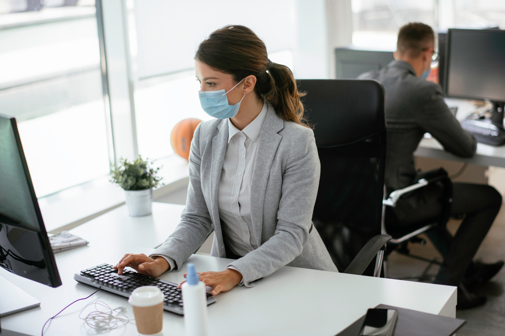 office location with workers wearing masks